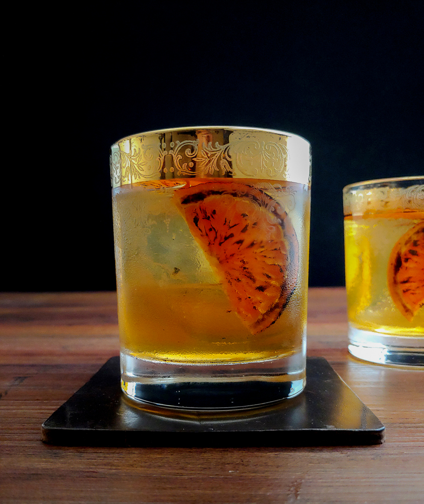 two cocktails with orange