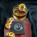 cocktail on a plate garnished with bananas