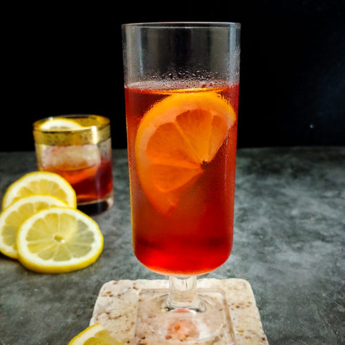 pink cocktail with lemon
