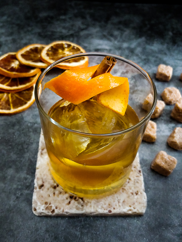 cocktail with orange and sugar cubes