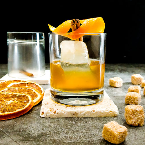 cocktail with orange peel and sugar cubes