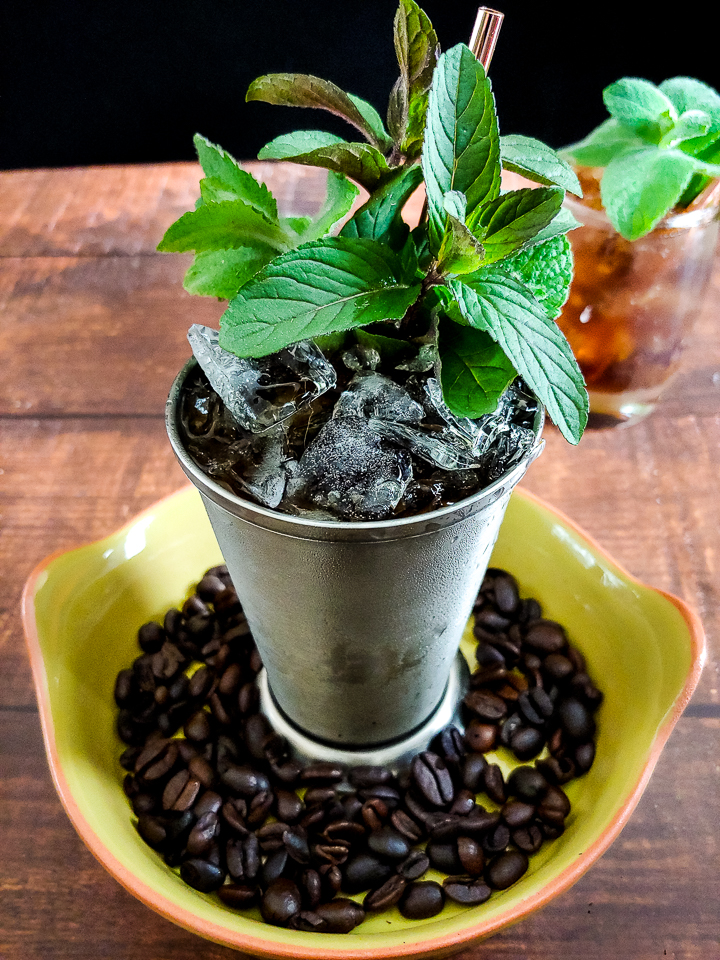Julep cocktail with mint and coffee bean garnish