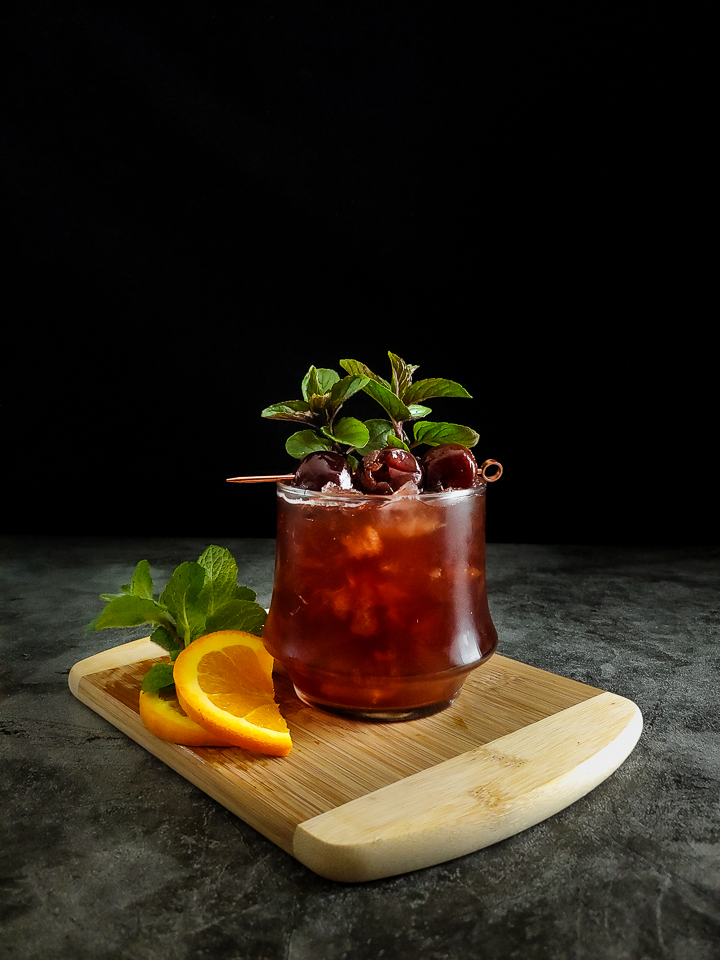Cherry cocktail with cherry and mint garnish