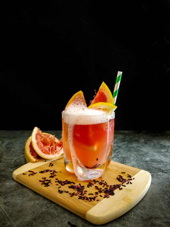 whiskey sour cocktail with grapefruit garnish