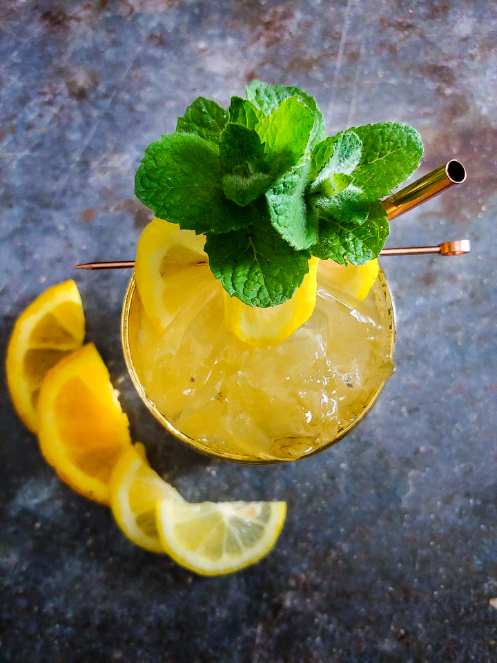 cocktail with mint and lemon garnish