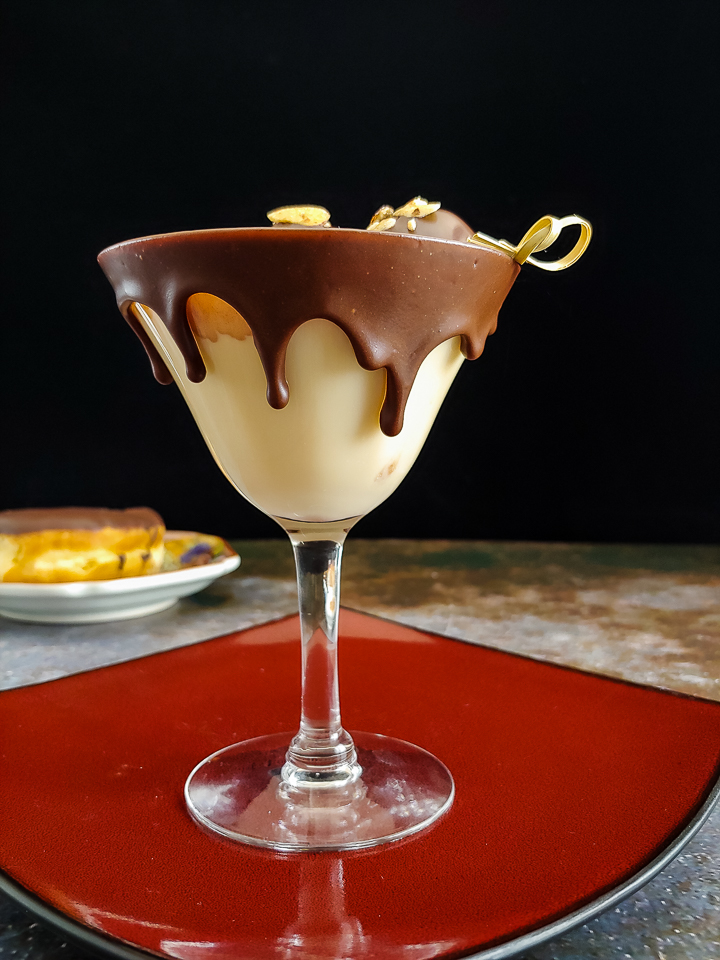 cream cocktail in chocolate dipped glass with donut holes