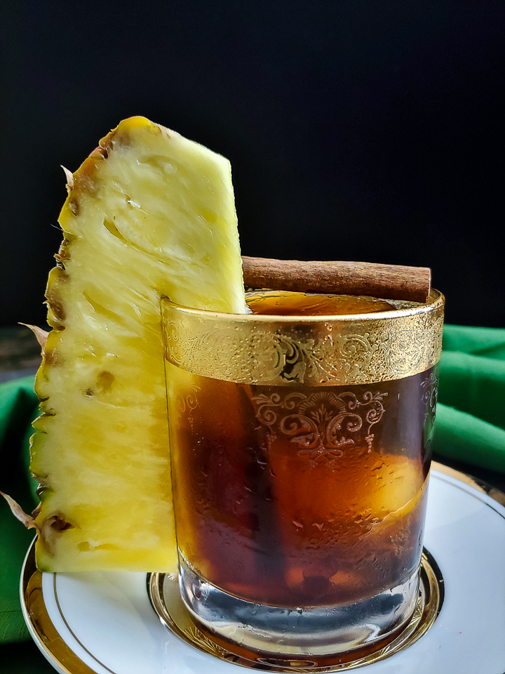 coffee cocktail with large pineapple garnish