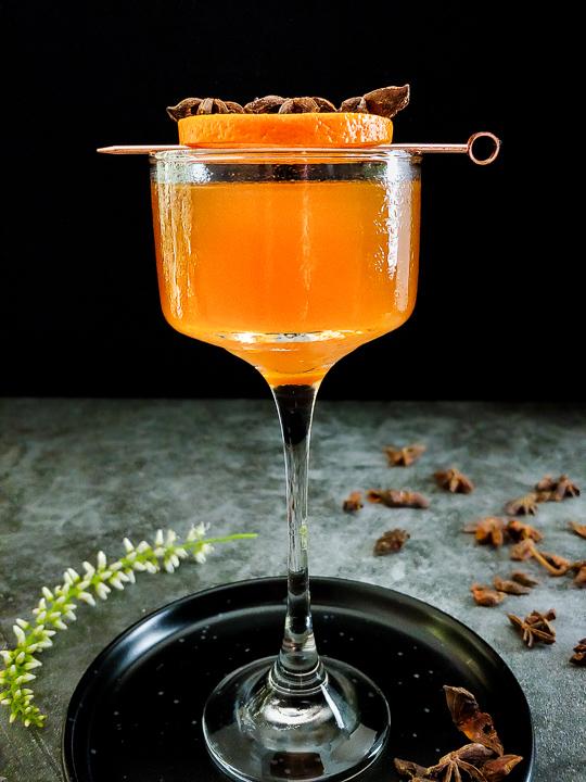 manhattan with orange and star anise garnish