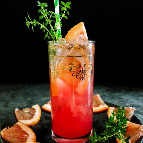 grapefruit highball with thyme and grapefruit garnish