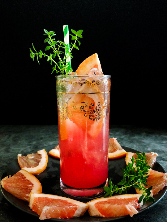 grapefruit highball with thyme and grapefruit garnish