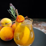 Peach Old Fashioned with peach rose and lavender sprig