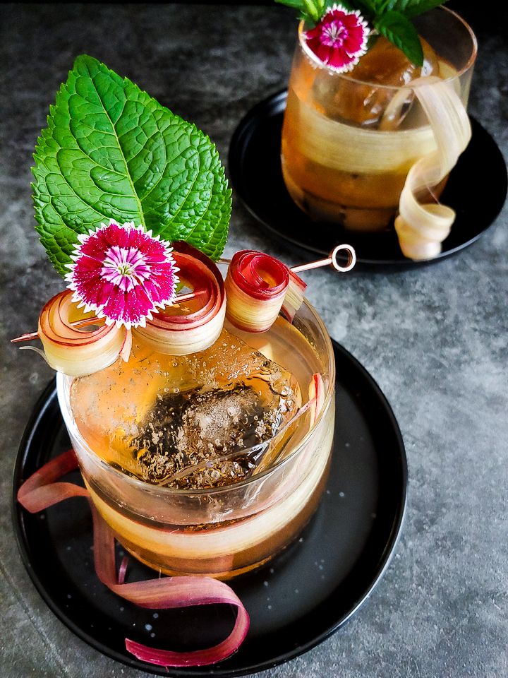 old fashioned cocktail with rhubarb roses, flowers and mint