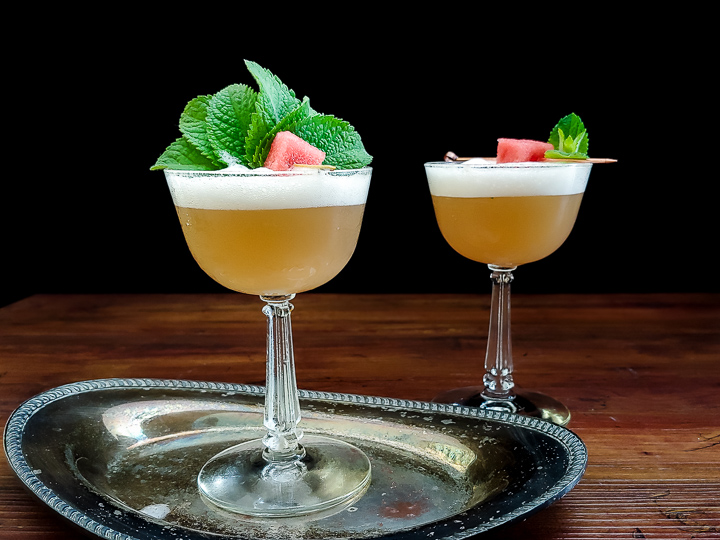 whiskey sour with watermelon and mint garnish