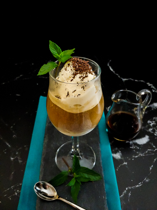ice cream coffee cocktail in a wine glass with chocolate