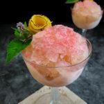 frozen sazerac garnished with lemon rose and mint