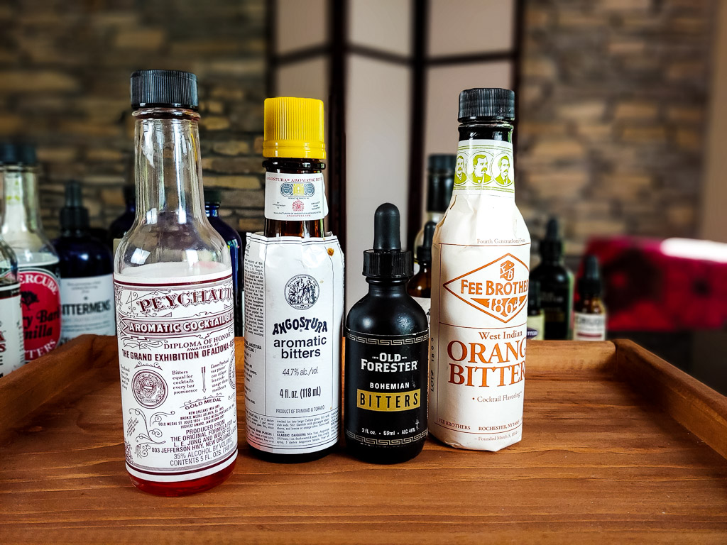 four bottles of basic bitters