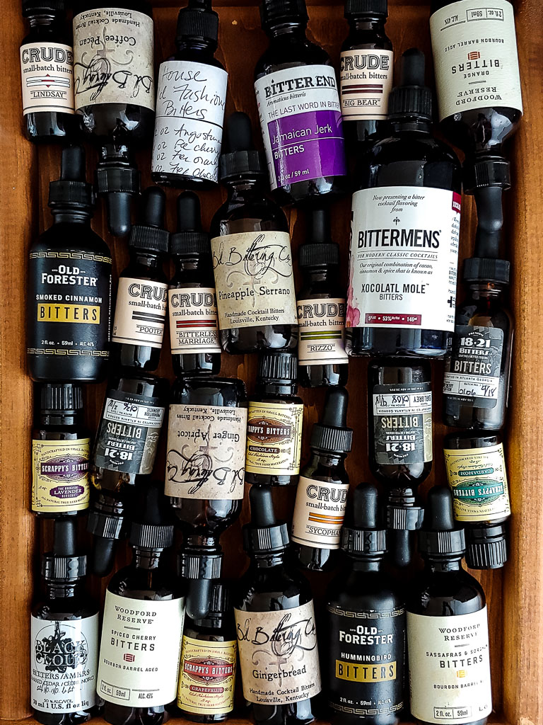 many bitters bottles of various sizes