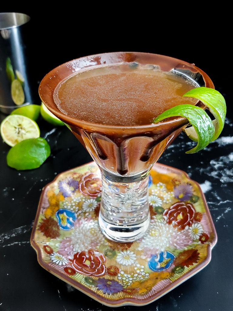 chocolate mocha daiquiri with mocha glaze drizzle on glass and lime garnish