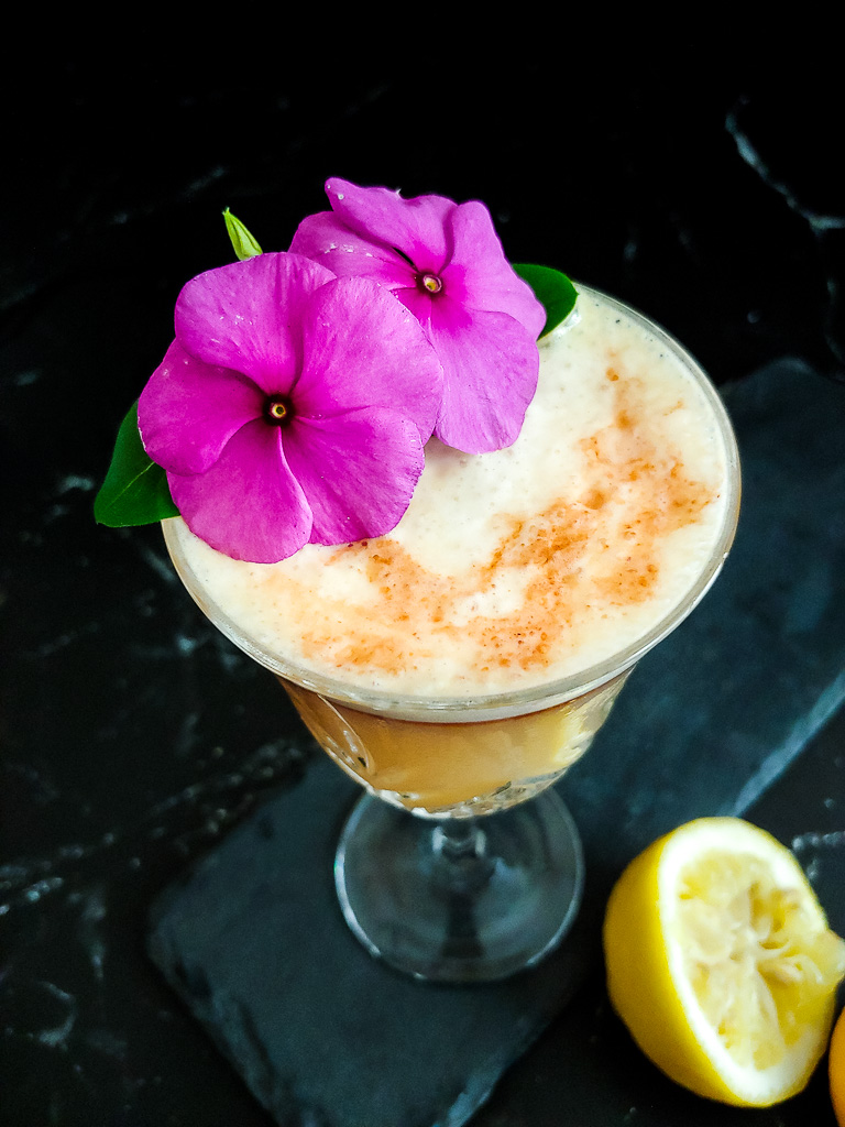Classic Boston Sour with flower and bitters to garnish