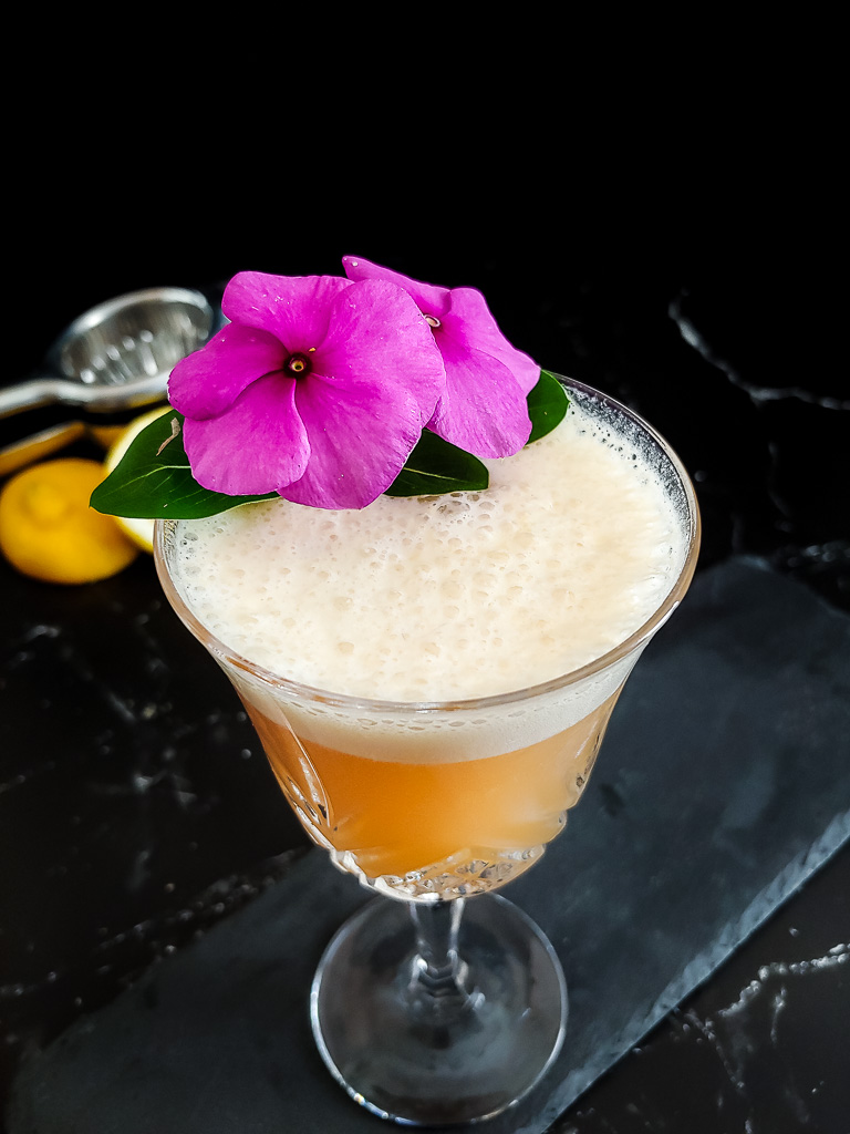 Classic Boston Sour with flower garnish