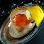 Classic Sazerac in rocks glass with lemon garnish. overhead shot