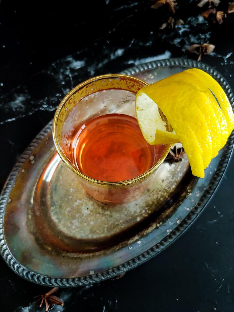 Classic Sazerac in rocks glass with lemon garnish. overhead shot
