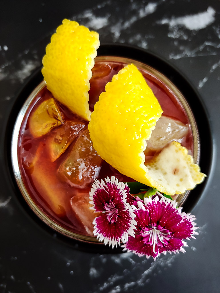 New York Sour - Whiskey sour with red wine float and lemon garnish