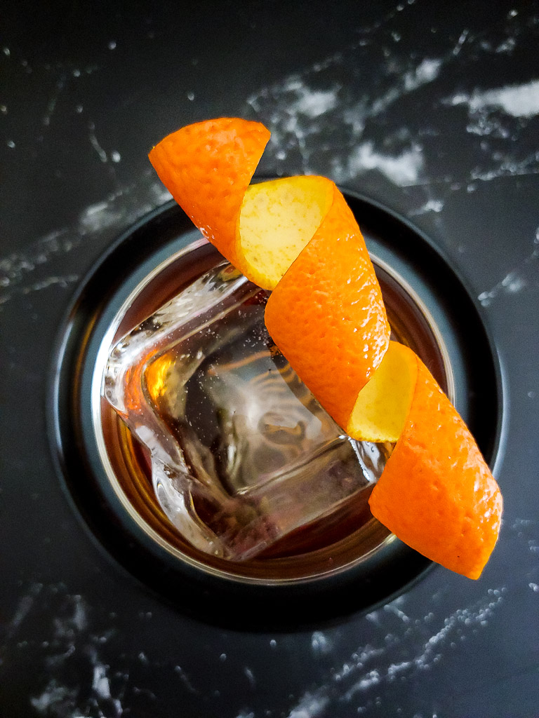 old fashioned cocktail with orange twist