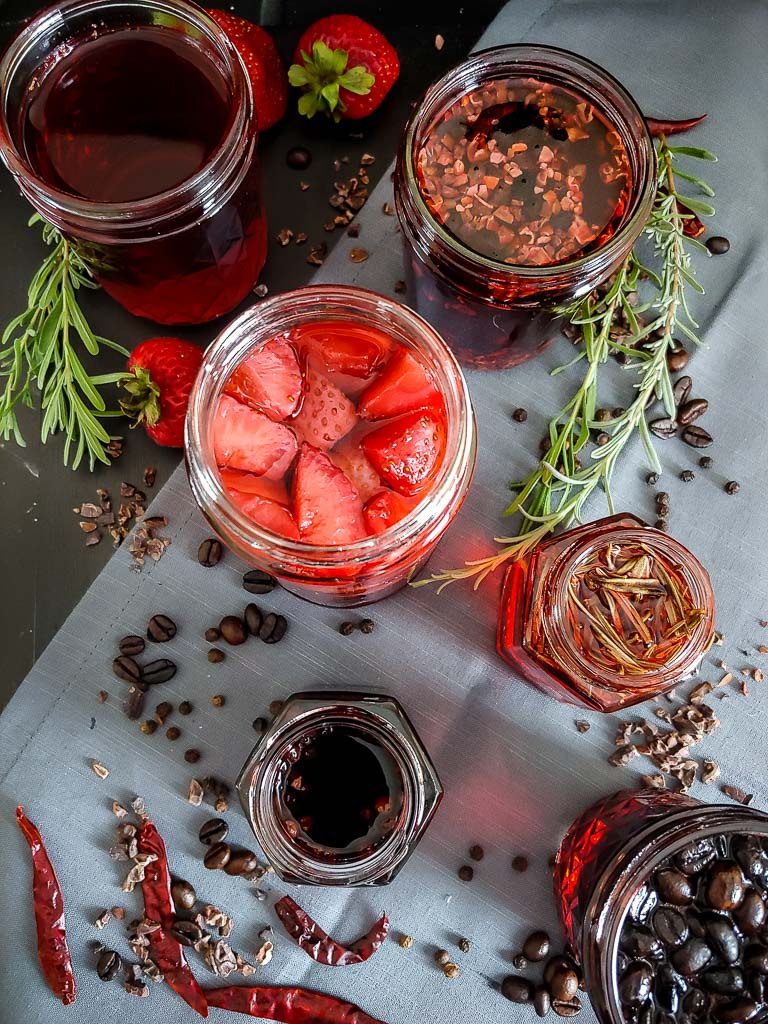 jars of campari infusions on tray