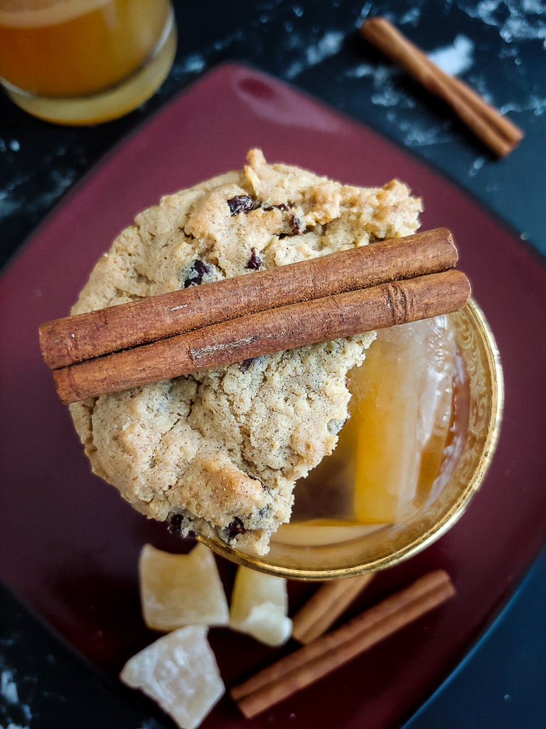 oatmeal cookie old fashioned with cookie and cinnamon stick garnish
