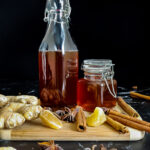 fall simple syrup in a jar surrounded by spices