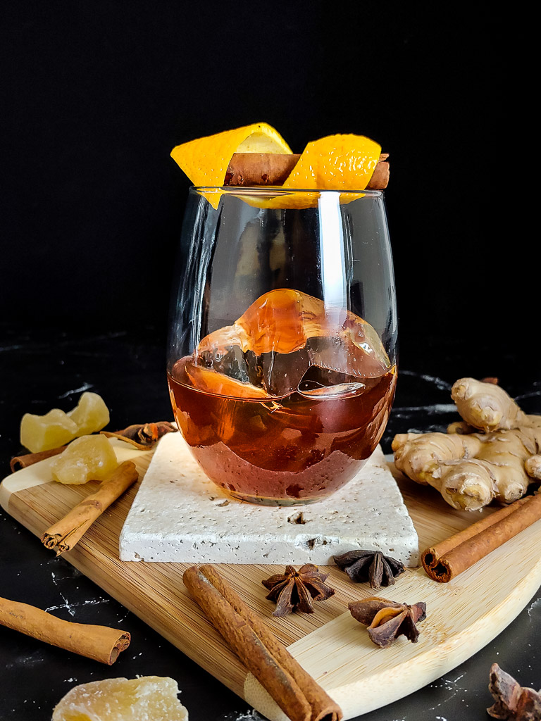 rum old fashioned on a cutting board with spices