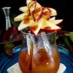 Caramel Apple Old Fashioned cocktail with apple fan and caramel drizzle