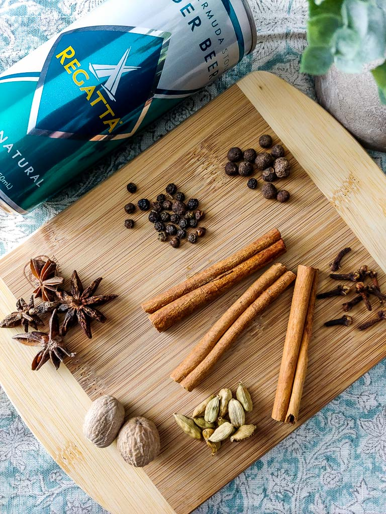 ginger beer and spices on board for chai spice infused simple syrup