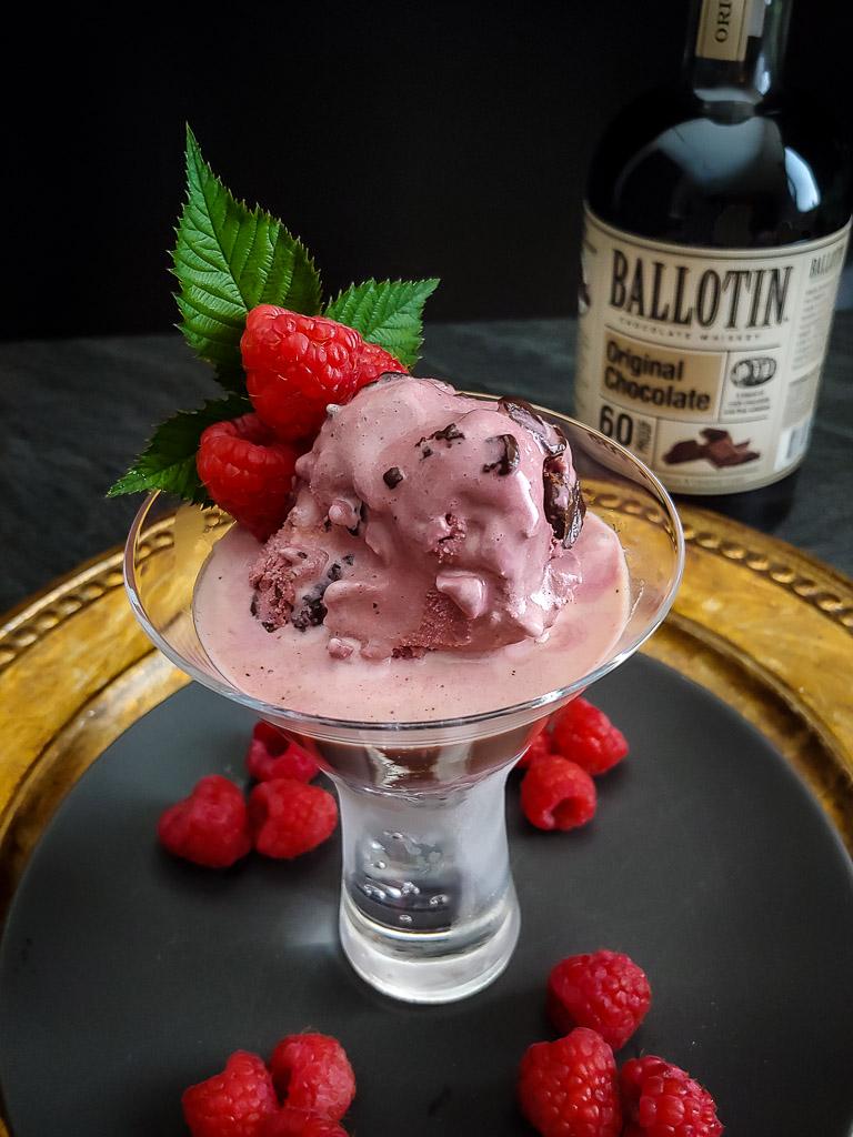 Chocolate affogato dessert with raspberry and raspberry leaf garnish