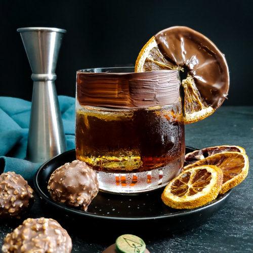 Chocolate Old Fashioned with chocolate rim and chocolate dipped orange garnish