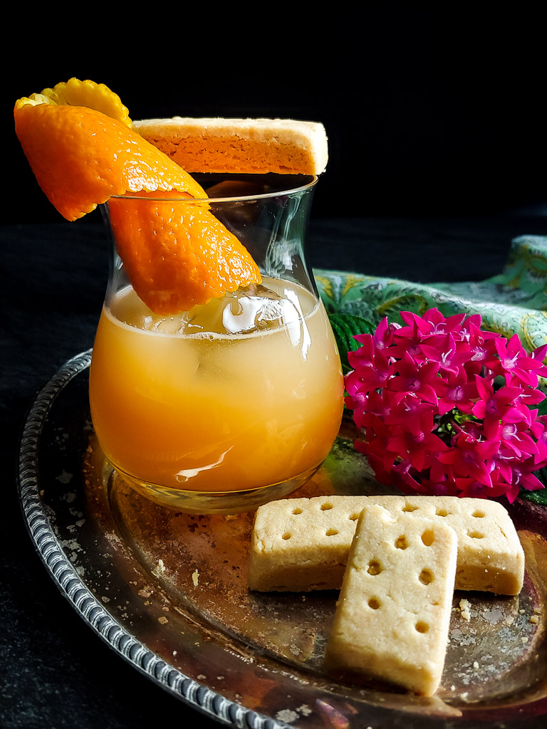 Earl Grey Old Fashioned with shortbread and orange garnish