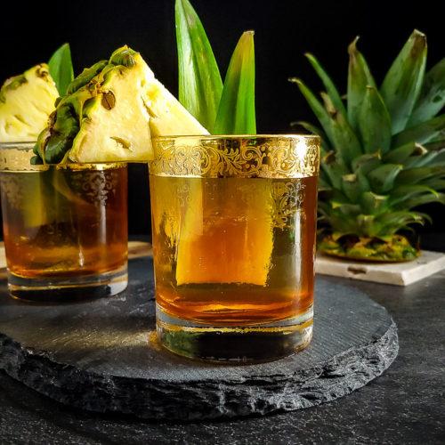 Rum tiki old fashioned with pineapple garnish