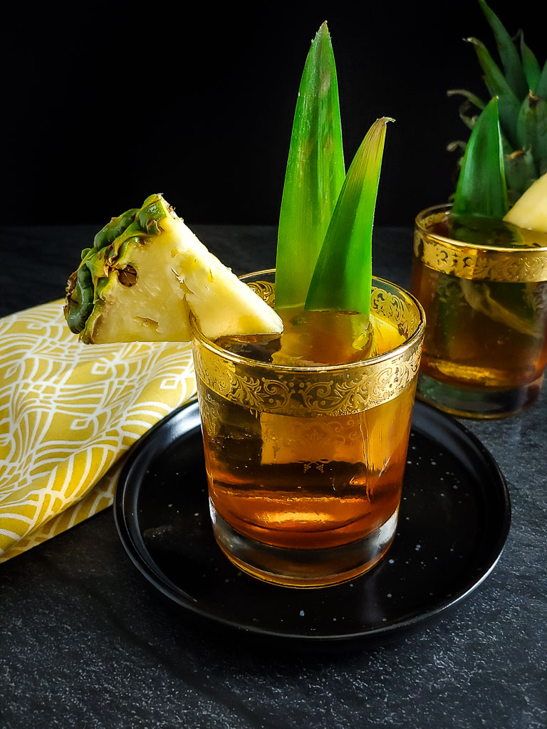 Rum tiki old fashioned with pineapple garnish