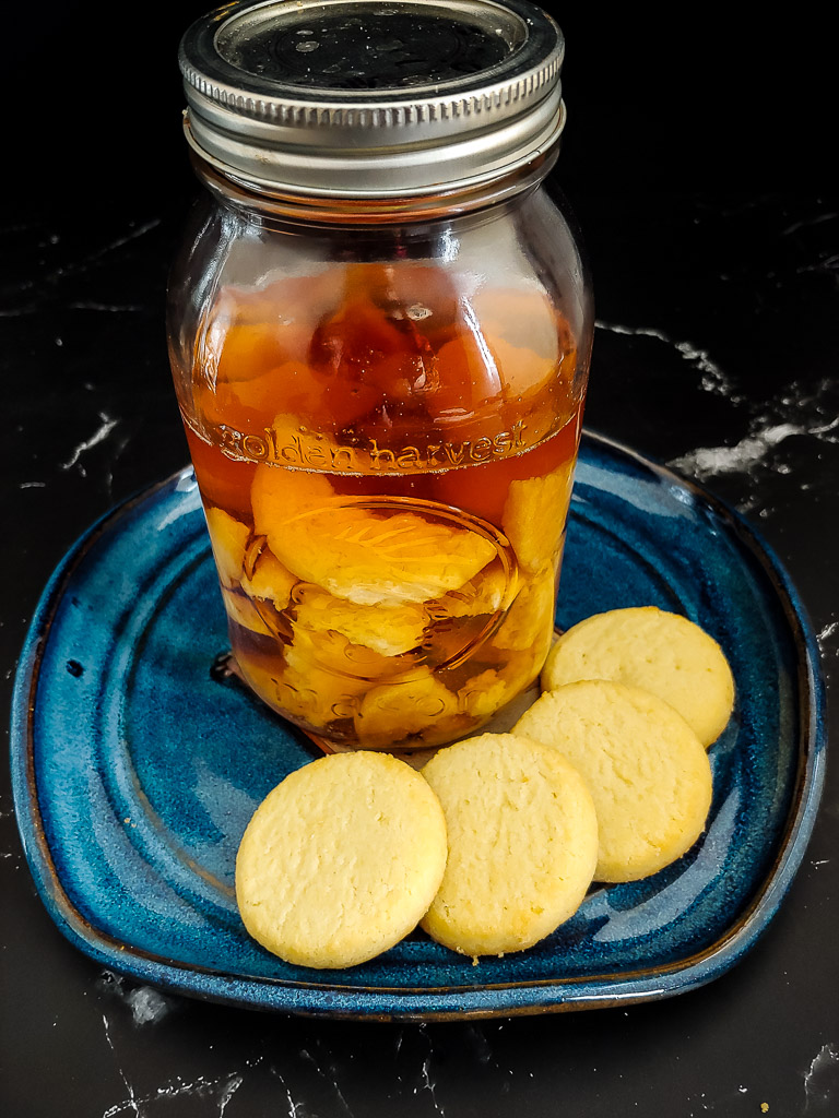 Shortbread Cookie-Infused Bourbon on a tray with cookies