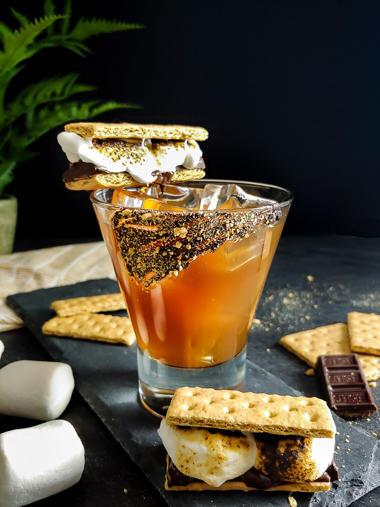 S'mores old fashioned with s'mores garnish and chocolate graham cracker rim