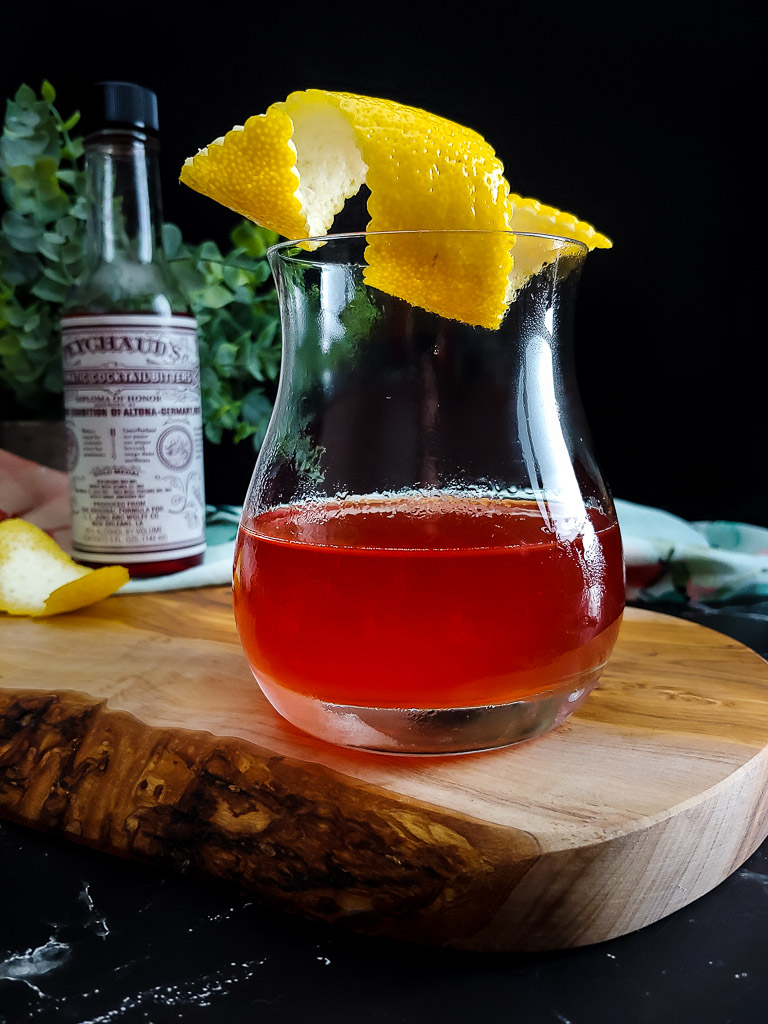 Sazerac cocktail with lemon garnish and Peychaud's bitters