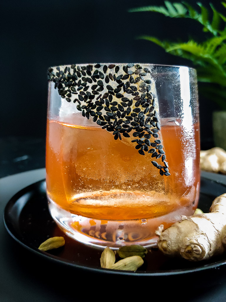 Fernet Sazerac cocktail garnished with sesame seed and ginger powder rim in rocks glass
