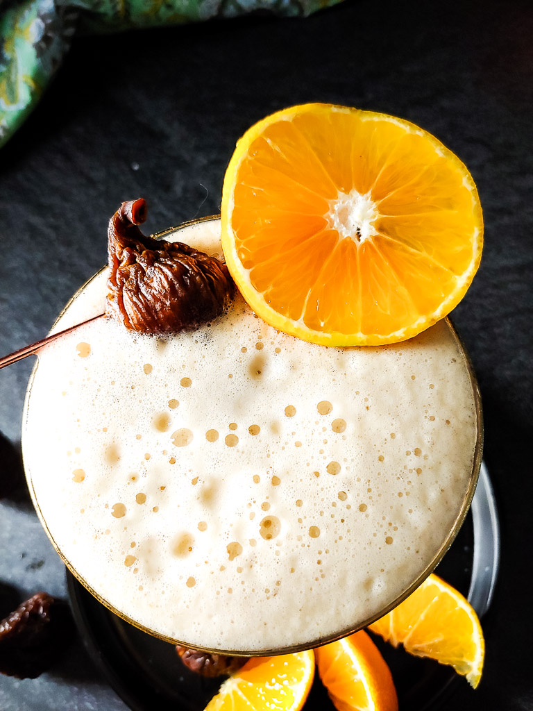 Mandarin Orange Fig Sour - foam-topped sour with fig and orange garnish