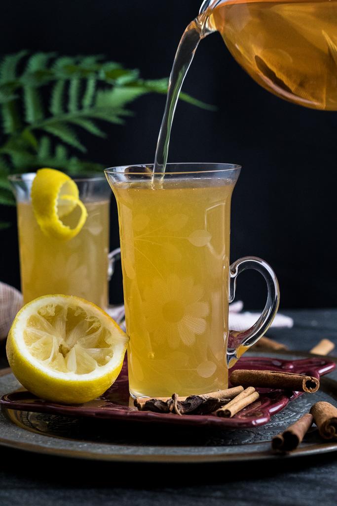 Cinnamon Toddy with lemon peel, cinnamon stick garnish, star anise