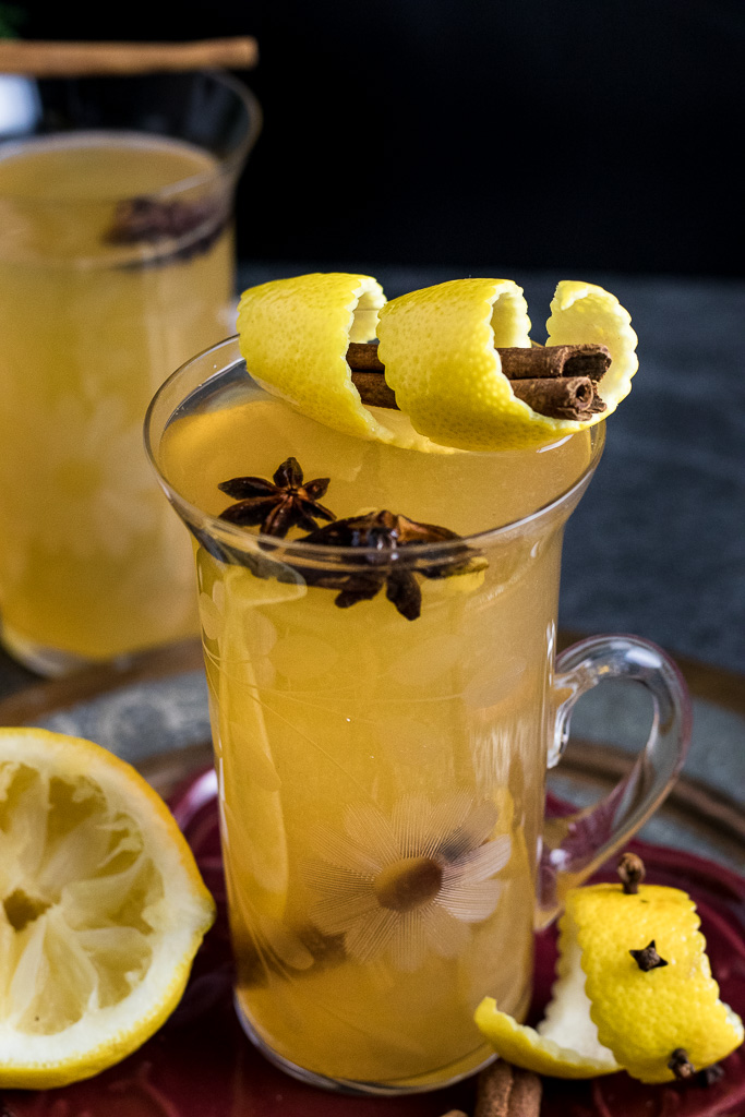 Cinnamon Toddy with lemon peel, cinnamon stick garnish