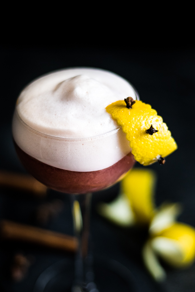 Uncle Nearest Cinnamon Sour with clove-studded lemon peel for garnish - served up