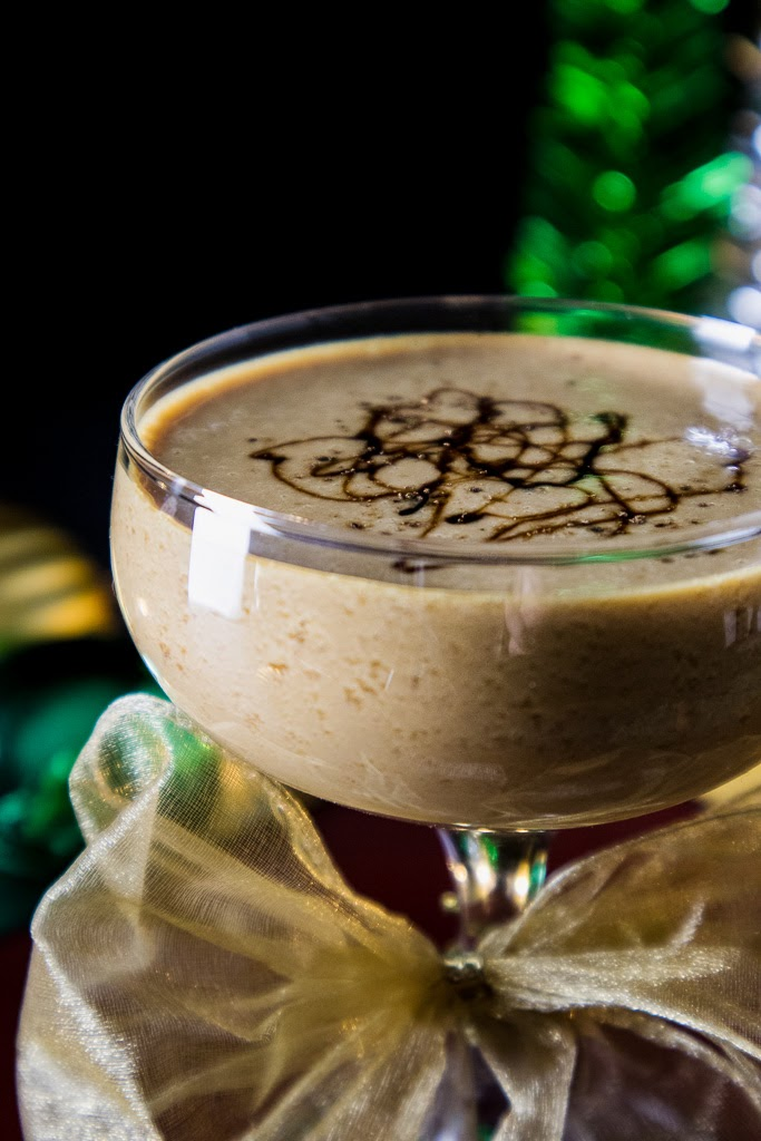 This gingerbread martini cocktail is full of the subtle flavors of a gingerbread cookie, the sweet and bitter, molasses, a hint of ginger, some vanilla notes from the whiskey and a bit of gingerbread bitters added.