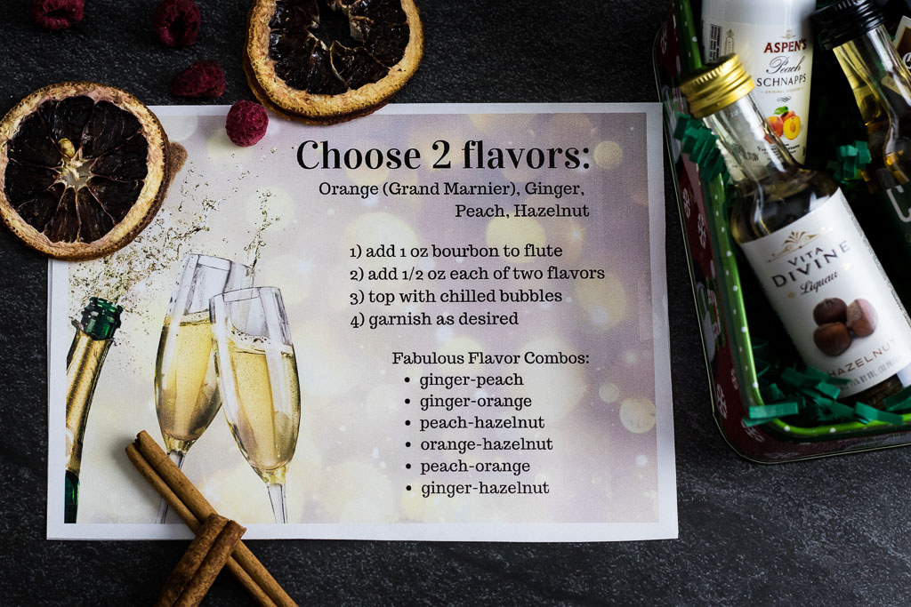 DIY Champagne Cocktail Kit example picture with small tin with 4 flavored liqueurs and dried fruit garnish