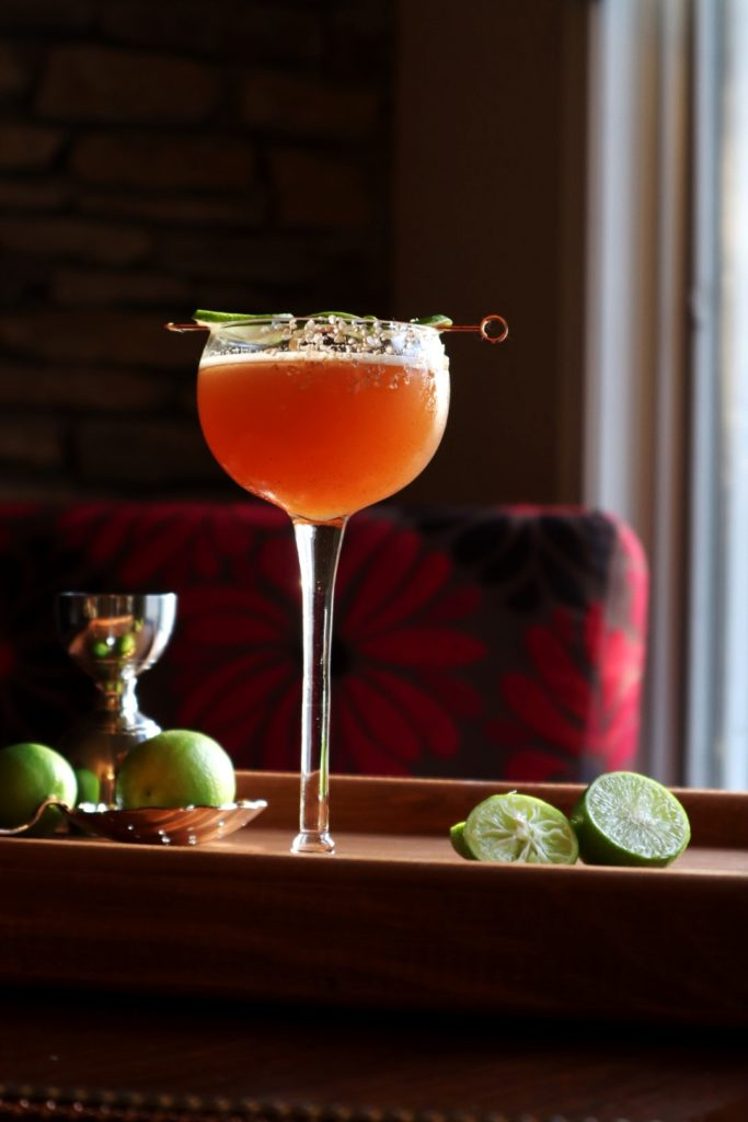 Lion's Tail Cocktail with lime wheel garnish